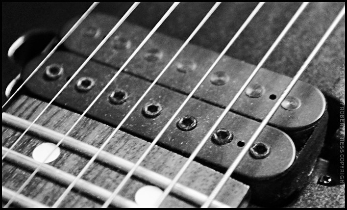 7 Strings - By Robert J. Tiess