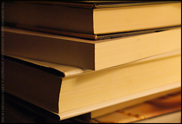 The Growing Pile of Books to Read - By Robert J. Tiess